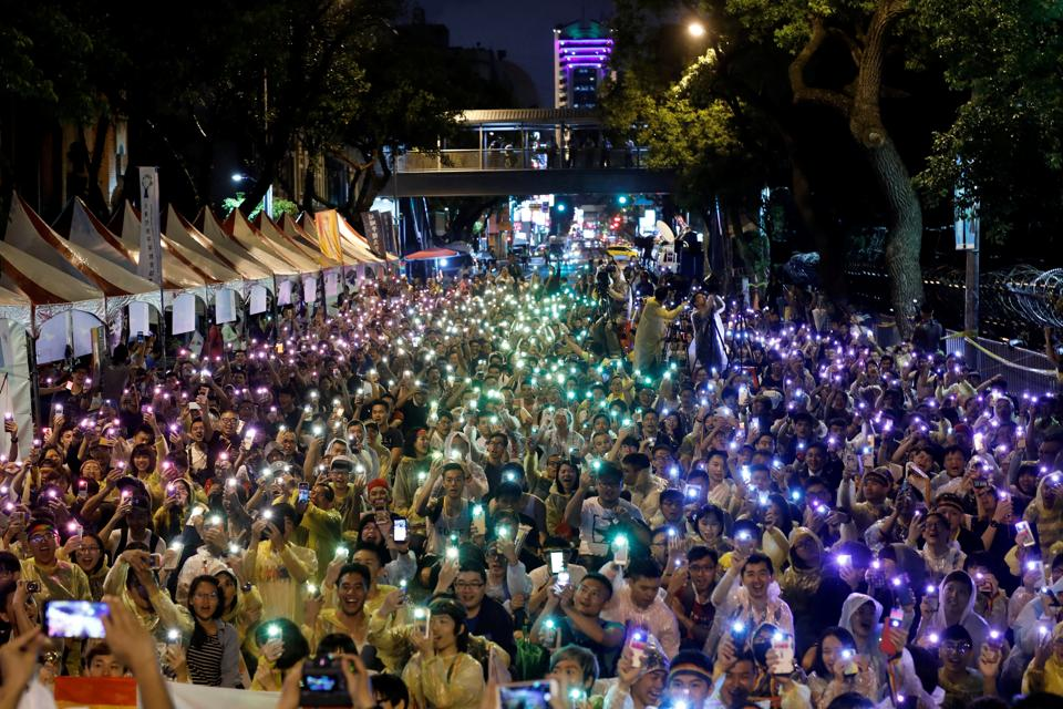 Supporters wave their mobile phone torches in the colors of the rainbow. It gave the government two years to implement the ruling. (Tyrone Siu/REUTERS)