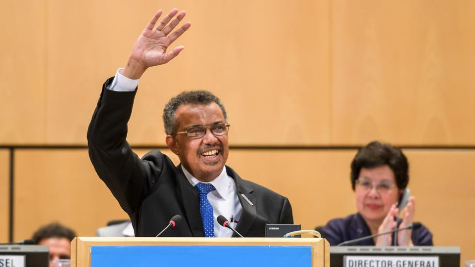 New World Health Organization (WHO) Director General, Ethiopia's Tedros Adhanom Ghebreyesus (L), waves after his election in front of outgoing Director General China's Margaret Chan (R), during the World Health Assembly (WHA) on May 23, 2017, in Geneva.