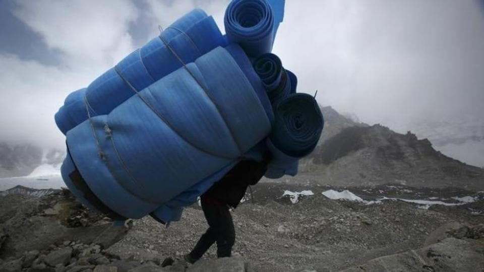 File photo of a porter carrying mattresses from the Everest base camp, approximately 5,300 metres above sea level, in Solukhumbu district of Nepal.