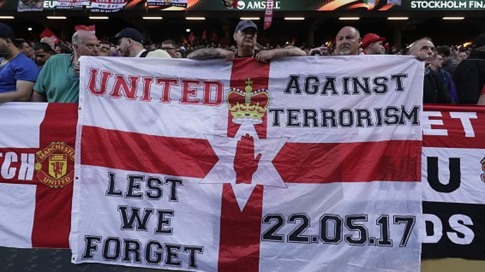 Manchester United fans hold up banners, in honour of the victims of the Manchester terrorism attack, during the UEFA Europa League final between Ajax and Man United at Friends Arena in Stockholm on Wednesday. (Getty Images)