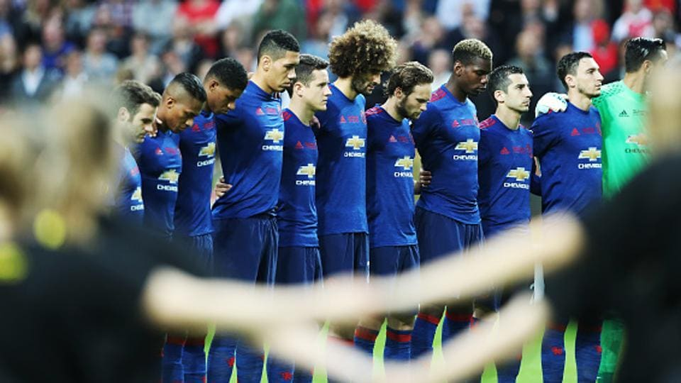 Manchester United players observe a minute's silence before the UEFA Europa League final match against Ajax Amsterdam at Friends Arena in Stockholm on Wednesday. The whole of the stadium stood in solidarity, observing silence to pray and honour the victims of the Manchester terror attack  on May 22. (Getty Images)