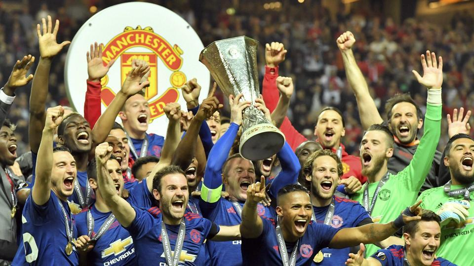 Manchester United players celebrate with the trophy after winning the UEFA Europa League crown, beating Ajax Amsterdam in the final at Friends Arena in Stockholm on Wednesday. Manchester United won 2-0 with Paul Pogba and Henrikh Mkhitaryan scoring for the English side. (AP)