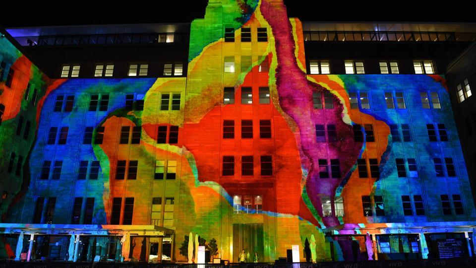 The Museum of Contemporary Art building is lit up during the media preview of the Vivid Sydney festival. (SAEED KHAN  / AFP)
