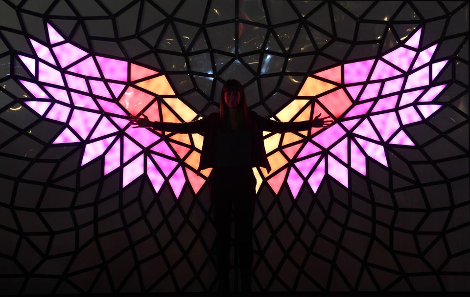 A woman poses in front of a light installation on the eve of the Vivid Sydney festival . Vivid Sydney, an annual festival of light, music and ideas, runs this year from May 26 to June 19. (SAEED KHAN  / AFP)