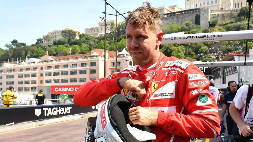 Ferrari's German driver Sebastian Vettel in the pits after the second practice session at the Monaco street circuit on Thursday, three days ahead of the Formula 1 Monaco Grand Prix.