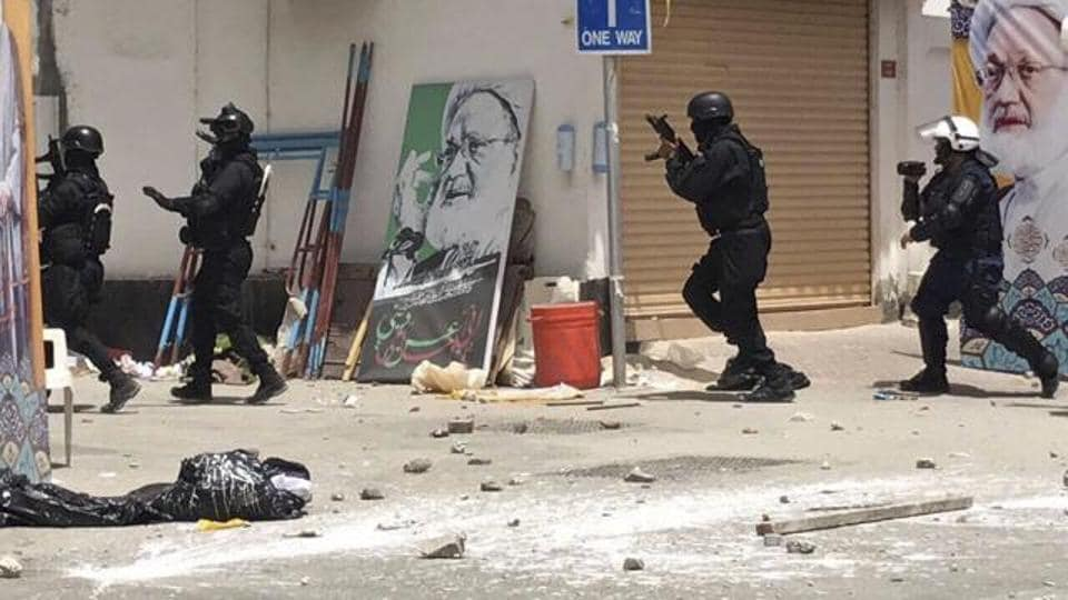 This image provided by an activist who requested to remain unnamed, shows Bahraini security forces during a raid on a sit-in demonstration, in Diraz, Bahrain, Tuesday, May 23, 2017.