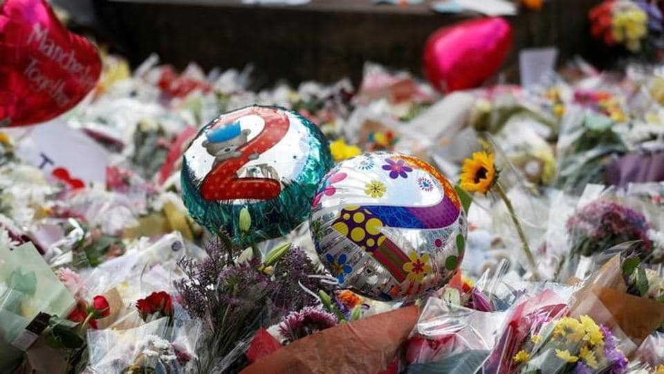 Balloons and floral tributes for the victims of the attack on the Manchester Arena are seen in St Ann's square in Manchester, Britain, on May 24.