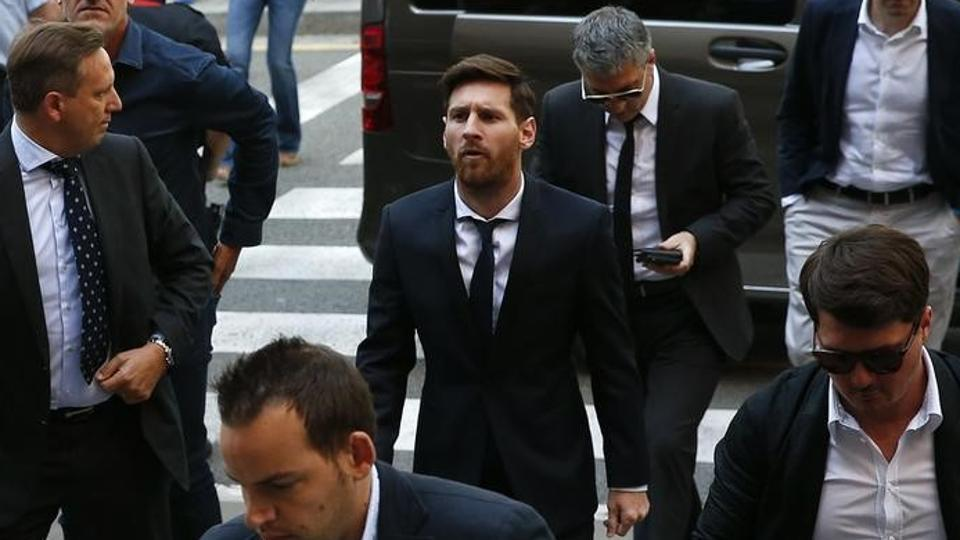 Barcelona's Argentine footballplayer Lionel Messi (C) arrives to court with his father Jorge Horacio Messi (3rd R) to stand trial for tax fraud in Barcelona.