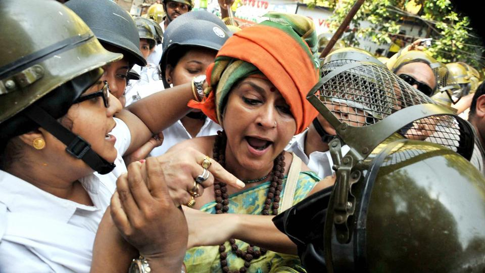 Actress-turned politician and BJP Rajya Sabha MP Rupa Ganguly clashes with the women police personnel during the protest. (PTI)