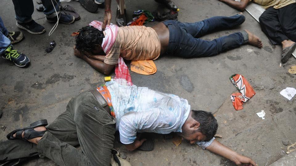 Injured BJPsupporters on Brabourne Road in central Kolkata on Thursday.