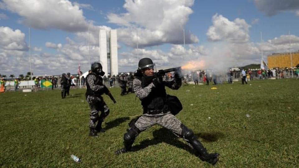 Riot police officers clash with demonstrators during a protest. (Ueslei Marcelino / Reuters)