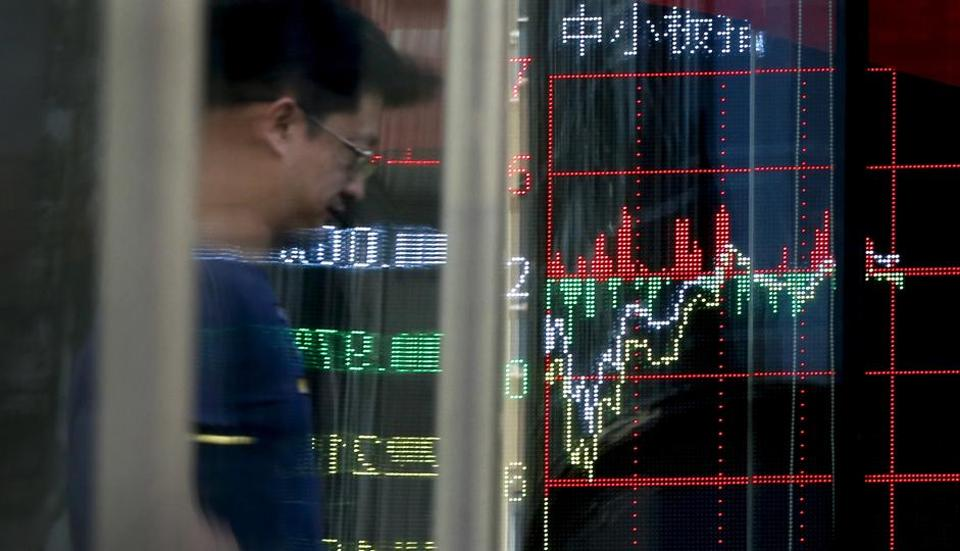 Chinese stocks sank on Wednesday after Moody's cut Beijing's government debt rating and other Asian markets rose following Wall Street's advance