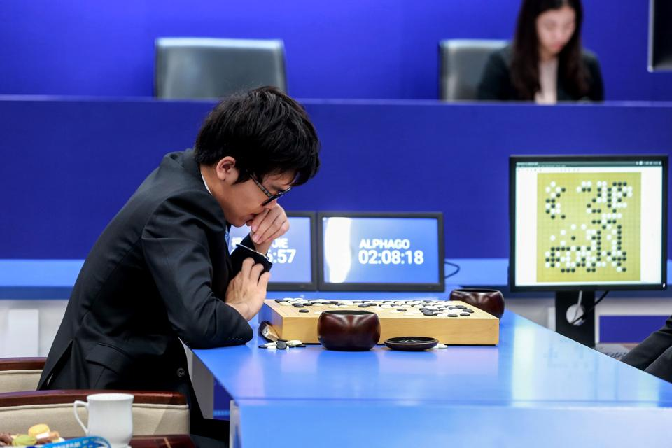 China's 19-year-old Go player Ke Jie prepares to make a move during the second match against Google's artificial intelligence programme AlphaGo in Wuzhen, eastern China, on Thursday.
