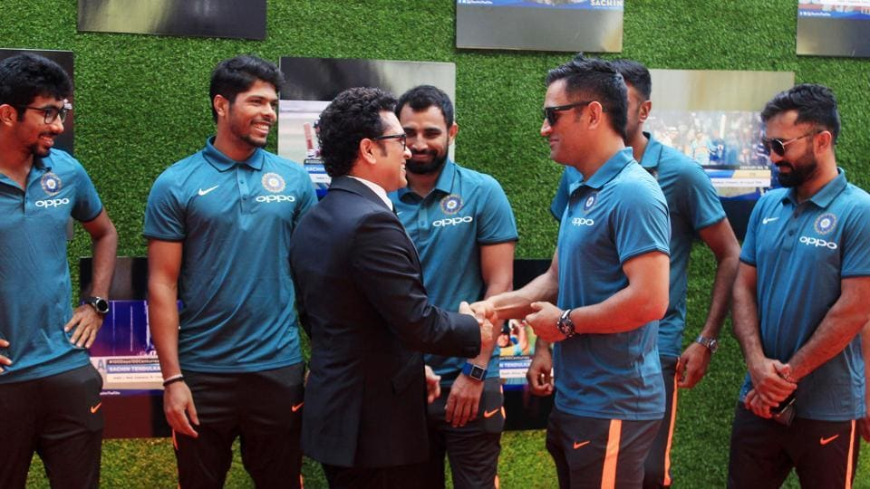 Sachin Tendulkar greets former Indian cricket team skipper MS Dhoni during a special screening of the movie 'SACHIN:A BILLION DREAMS in Mumbai on Wednesday.