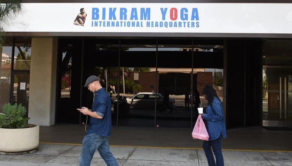 People walking past the headquarters of Bikram Yoga in Los Angeles, California on April 1, 2015.