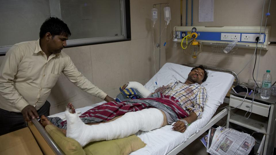 A man attacked by a group of people while returning from a rally, at a government hospital in Meerut, about 65 kilometers from New Delhi on May 24.