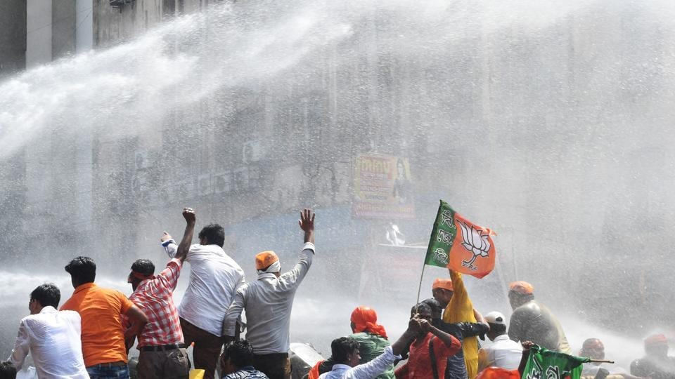 Police personnel  fire  water cannons at activists of the Bhartiya Janata Party (BJP) next to the state police headquarters in Kolkata. The saffron party's workers, led by Ghosh, marched towards the city police headquarters at Lalbazar in the central part of the city, but were stopped by the police on Brabourne road near their destination. (Dibyangshu  Sarkar/AFP)