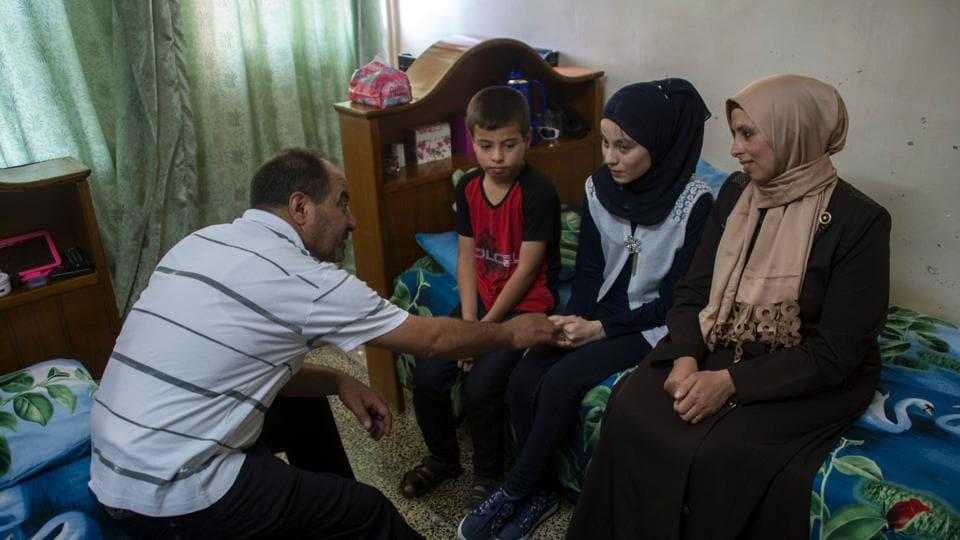 Nour al-Ta'i, a 15-year-old blind resident of East Mosul and participant in