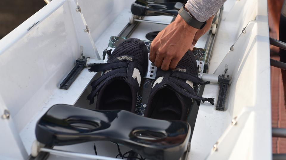 Adjusting the position of shoes before embarking on a race.  (Mujeeb Faruqui/HT Photo)