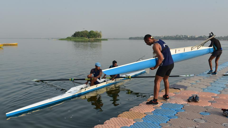 Rowers remove boats from the water after training. The Madhya Pradesh sports department has purchased shells which helps rowers improve performance and was used in the Rio Olympics. (Mujeeb Faruqui/HT Photo)