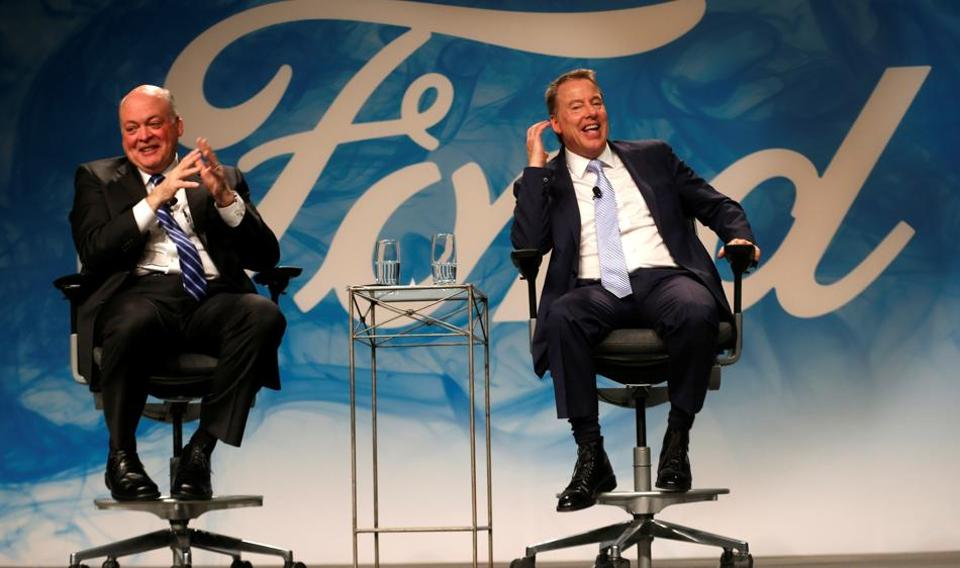 Ford Motor executive chairman Bill Ford (R) and James Hackett answer questions from the media after announcing Hackett was named as Ford Motor Company president and CEO, succeeding Mark Fields, in Dearborn, Michigan.