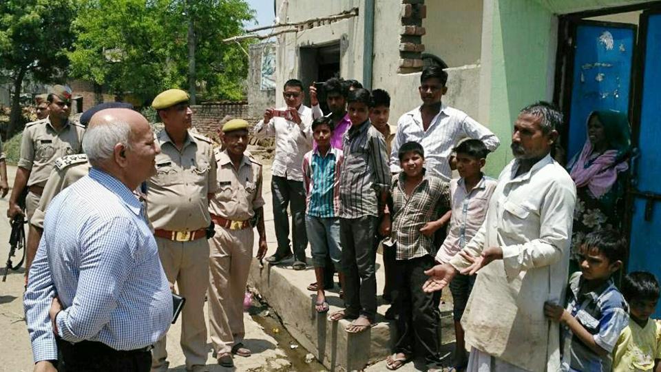Uttar Pradesh home secretary Mani Prasad Mishra interacts with villagers in Shabeerpur on Wednesday.
