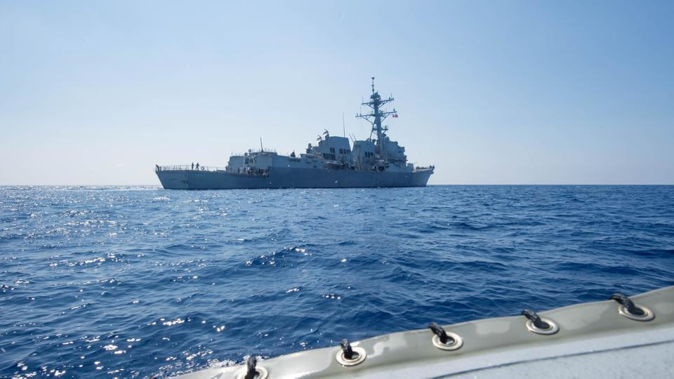 Arleigh Burke-class guided-missile destroyer USS Dewey transits the South China Sea on May 6.
