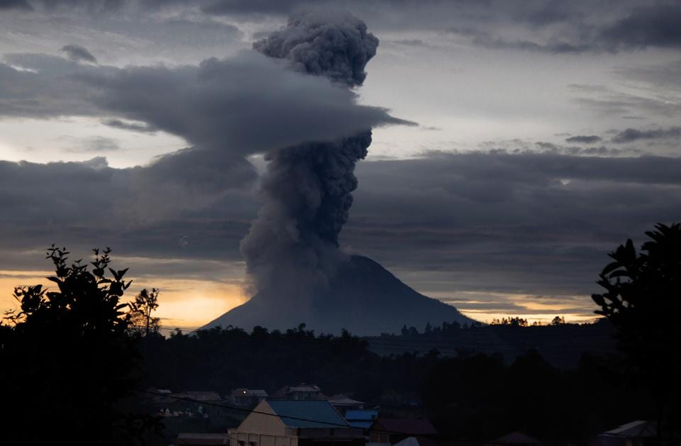 Mount Sinabung volcano spews thick volcanic ash, as seen from Brastagi, in Karo, North Sumatra province. Sinabung roared back to life in 2010 for the first time in 400 years. After another period of inactivity, it erupted once more in 2013 and has remained highly active since.  (TIBTA PANGIN / AFP)
