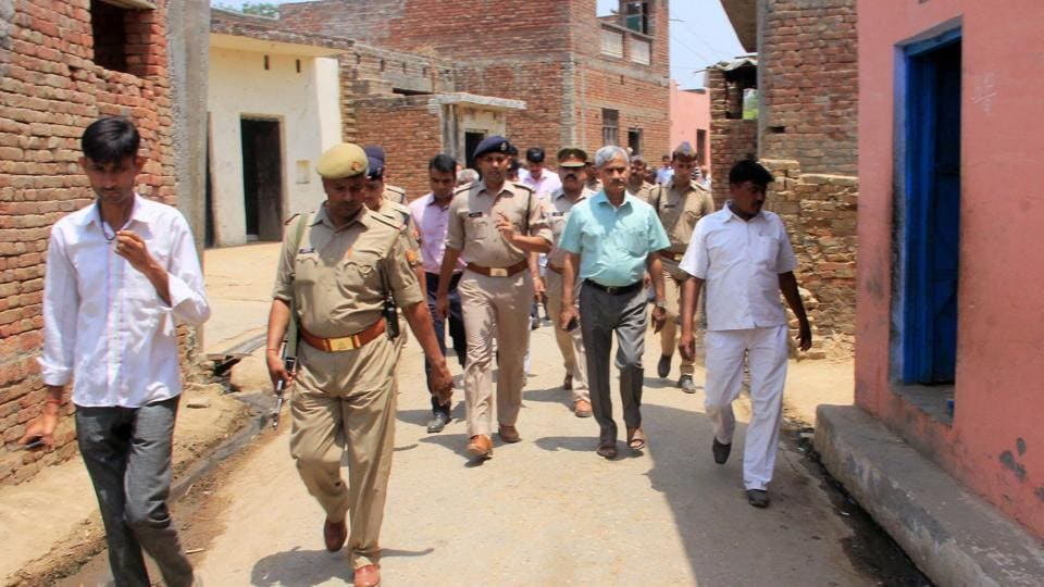 Administrative officials and the police patrol in the violence-hit Sabbirpur village of Saharanpur district on Thursday.