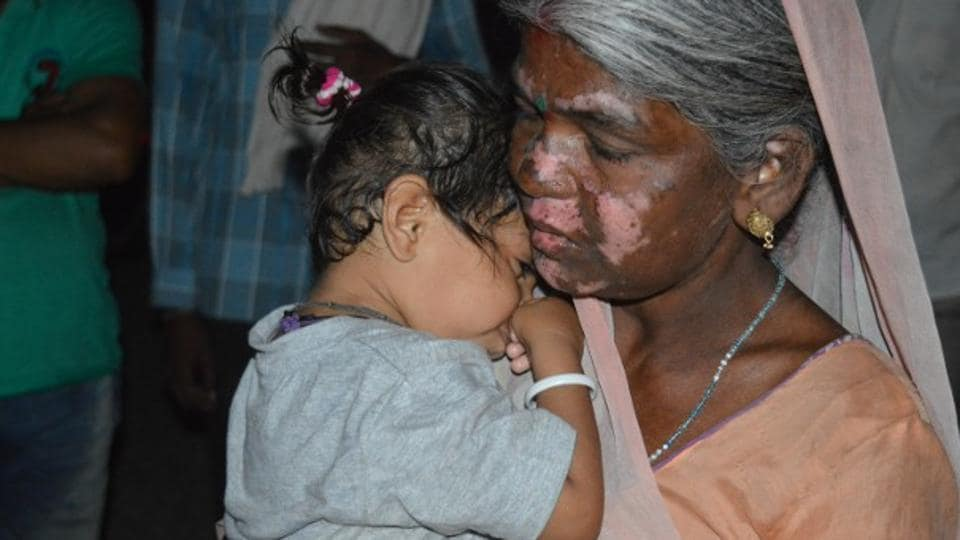 The child Devi Singh with his aunt after Damoh district child welfare committee handed him over to her at Damoh on Thursday evening.
