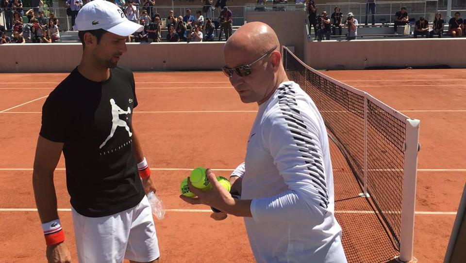 Novak Djokovic and Andre Agassi (right) during a training session ahead of the French Open