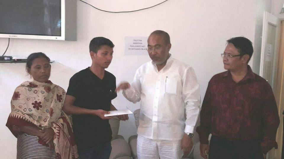 Manipur chief minister N Biren Singh felicitates Thounaojam Loyangamba Meitei.