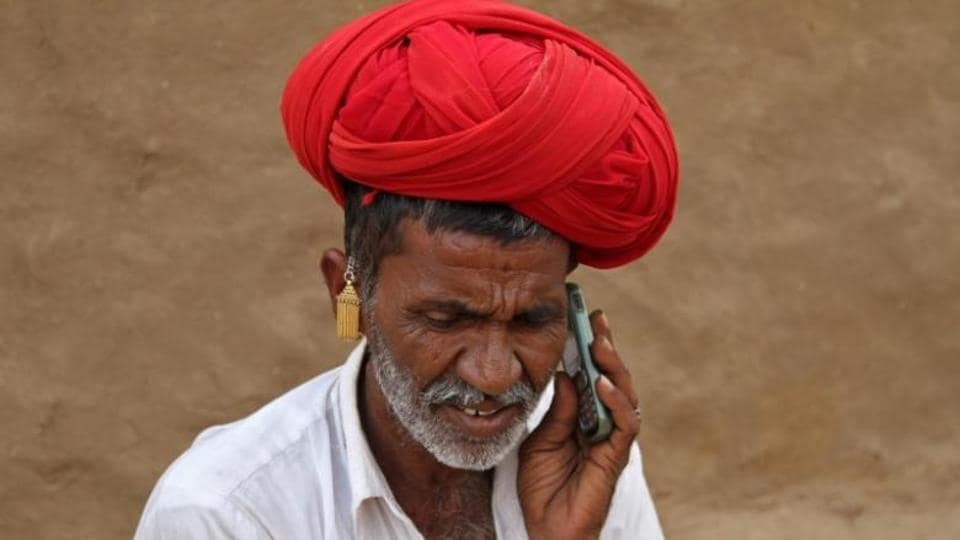 A man talks on his mobile phone in the village in Rajasthan