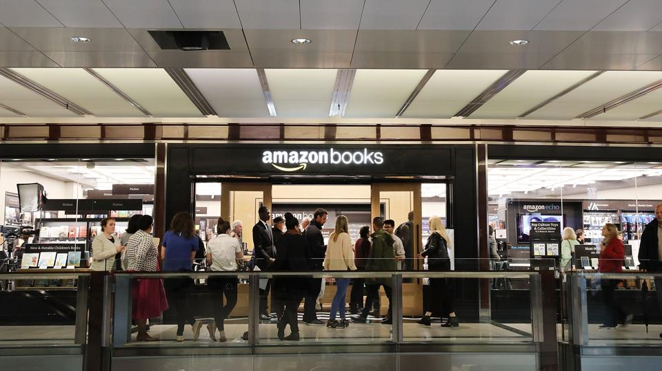 People enter the newly opened Amazon Books in New York City. Amazon.com Inc.'s first New York City bookstore occupies 4,000 square feet in The Shops at Columbus Circle in Manhattan and stocks upwards of 3,000 books.