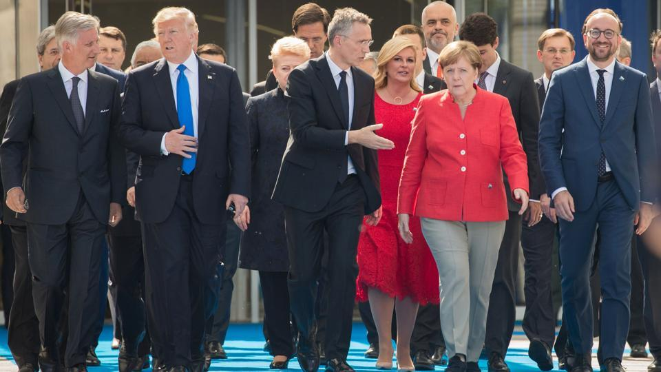 (L-R) Belgium's King Felipe, US President Donald Trump, NATO Secretary General Jens Stoltenberg, German Chancellor Angela Merkel and Belgian Prime Minister Charles Michel arrive to the unveiling ceremony of the new headquarters of NATO (North Atlantic Treaty Organization) on May 25, 2017 in Brussels during a NATO Summit.