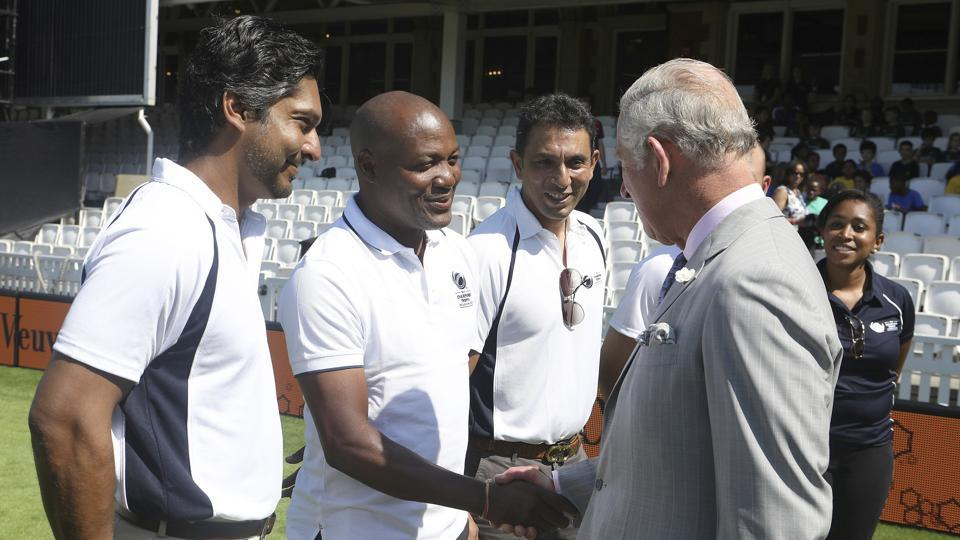 Britain's Prince Charles, the Prince of Wales, interacts with Kumar Sangakkara, Brian Lara and Azhar Mahmood during the launch. (AP)