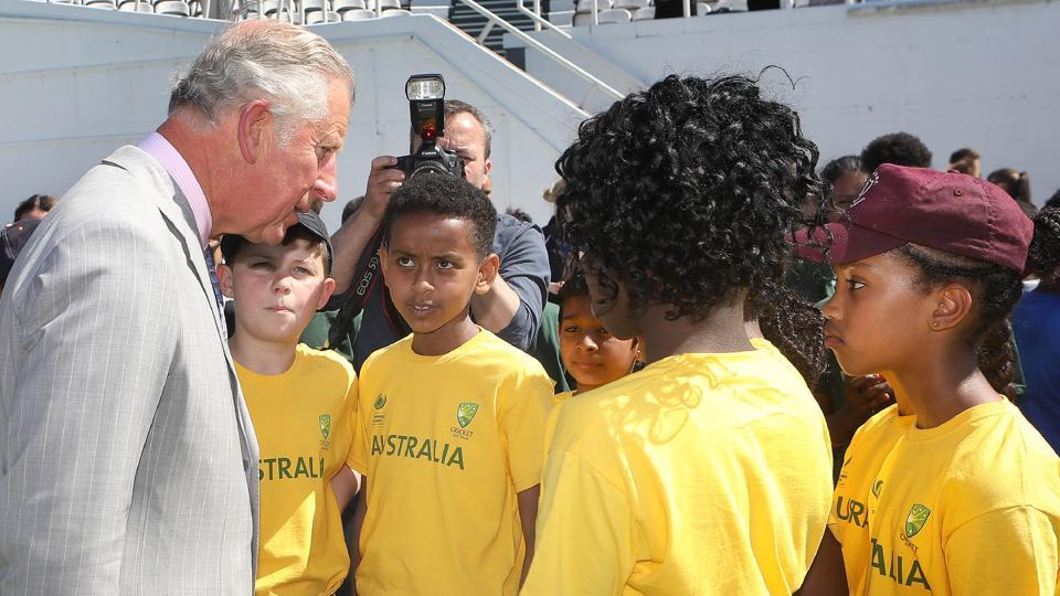 Britain's Prince Charles, Prince of Wales meets children taking part in a youth cricket competition. (AFP)
