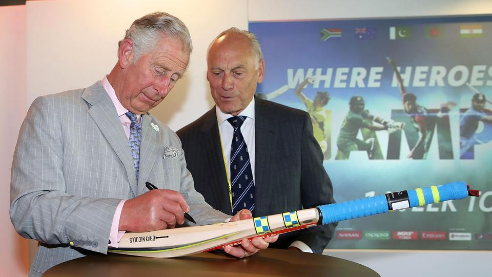 Britain's Prince Charles signs a cricket bat, which will be donated to charity, during the launch of the ICC Champions Trophy 2017. (AFP)