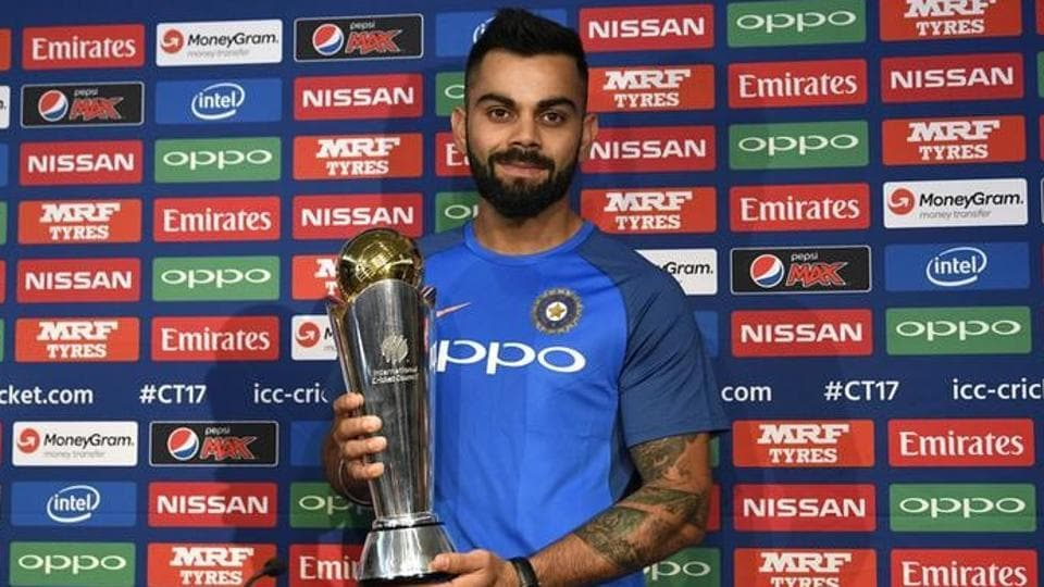 India captain Virat Kohli poses with the ICC Champions Trophyduring a press conference ahead of the 50-over tournament.