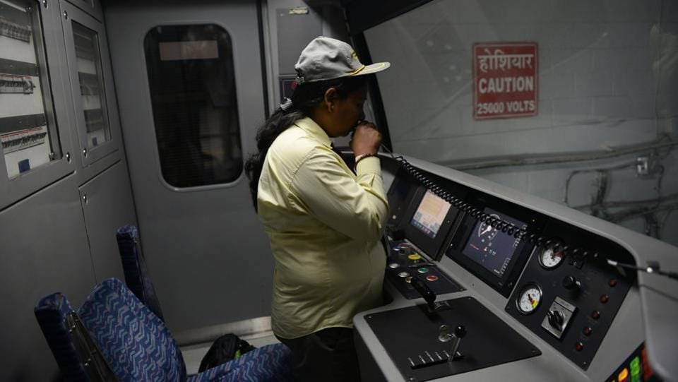 A driver of the Indian Delhi Metro Rail Corporation (DMRC) talks before driving a train on the new Heritage Line in New Delhi . The entirely underground 5.17 kilometre-long section of the Delhi metro is called the heritage line that passes through various historical landmarks of Old Delhi.  (AFP)