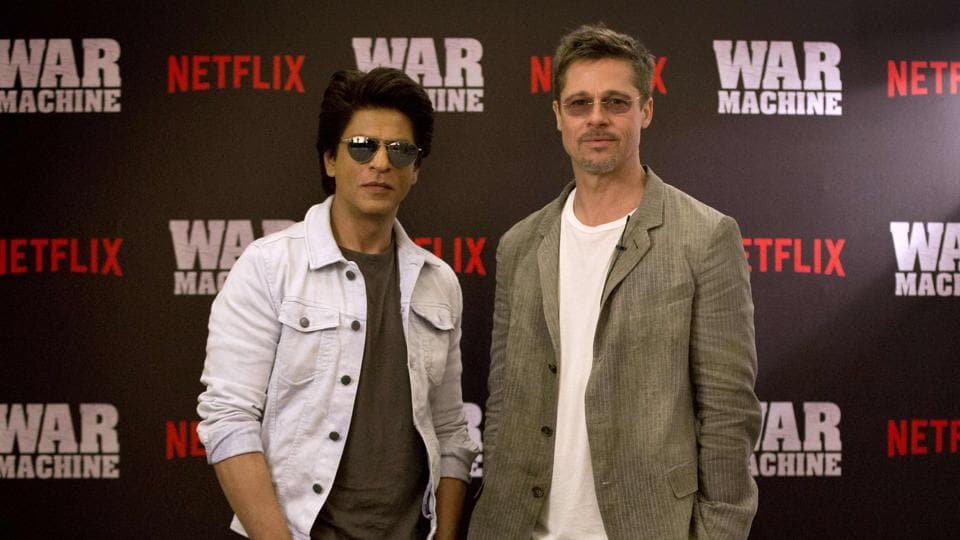 In this handout photograph released by Netflix on May 24, 2017, Shah Rukh Khan and Brad Pitt pose for a photograph during the Indian premiere of forthcoming Netflix film War Machine in Mumbai.