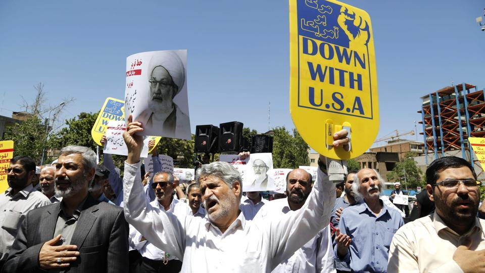 Iranian protestors hold banners in the capital Tehran on May 26, 2017 during a demonstration in support of top Bahraini Shia cleric Isa Qassim, who was sentenced on May 21 to a suspended one-year jail term.