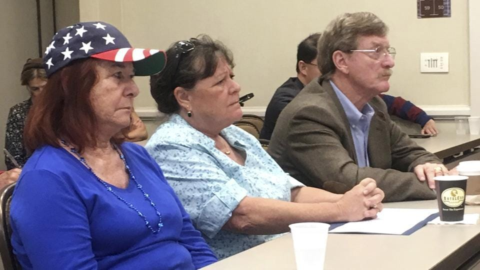 Supporters of a lawsuit against the San Diego school district listen during a news conference in San Diego, Calif., Thursday, May 25, 2017. Six parents have sued the San Diego school district, alleging that its anti-Islamophobia campaign favors Islam over other religions and grants special protections to Muslim students.