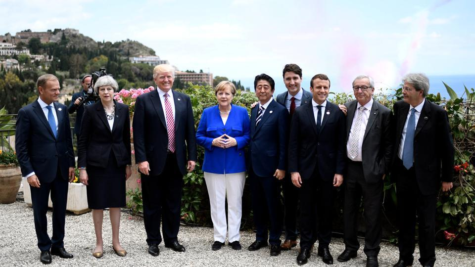 (L-R) The President of the European Council Donald Tusk, Britain's Prime Minister Theresa May, US President Donald Trump, German Chancellor Angela Merkel, Japanese Prime Minister Shinzo Abe, Canadian Prime Minister Justin Trudeau, French President Emmanuel Macron, the President of the European Commission Jean-Claude Juncker and Italian Prime Minister Paolo Gentiloni pose as part of the G7 Summit in Taormina, Sicily, Italy on May 26.