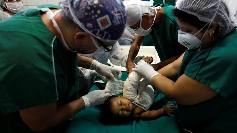 Doctors wrap a child's burnt skin with sterilised tilapia fish skin. Once cleaned and treated, it can last for up to two years, researchers say. The treatment removes any fish smell. (Paulo Whitaker / Reuters)