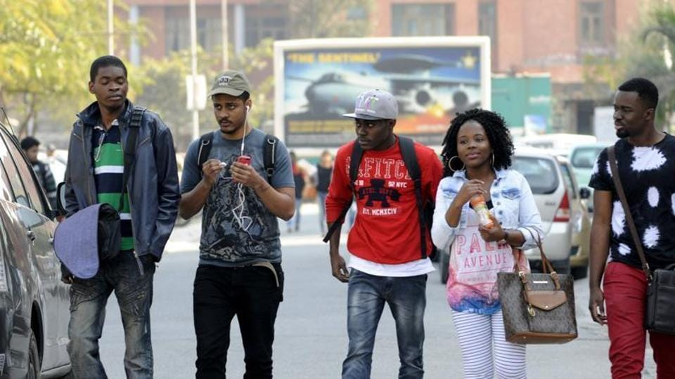 African students walk to their university in Greater Noida in February.