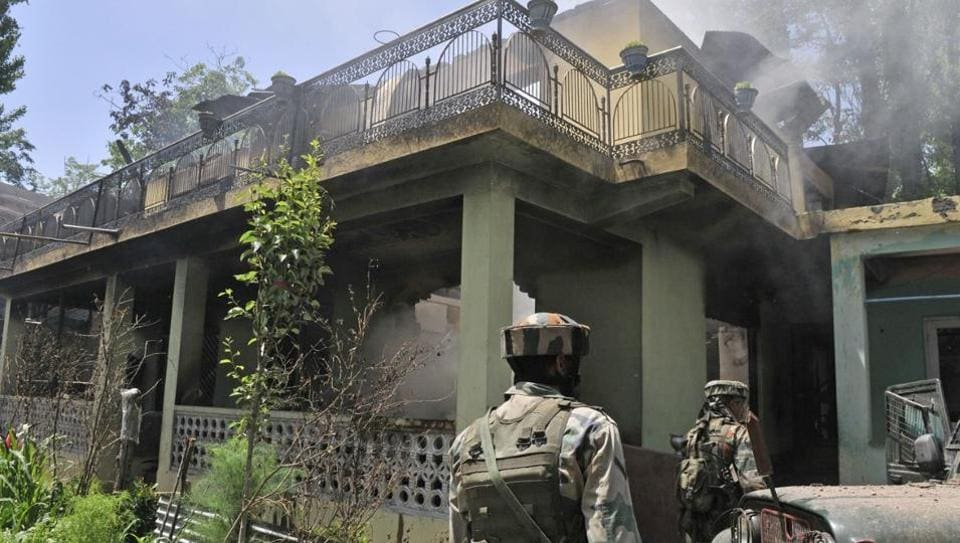 Security forces  after an encounter with militants in Tral, Jammu and Kashmir, May 27, 2017.