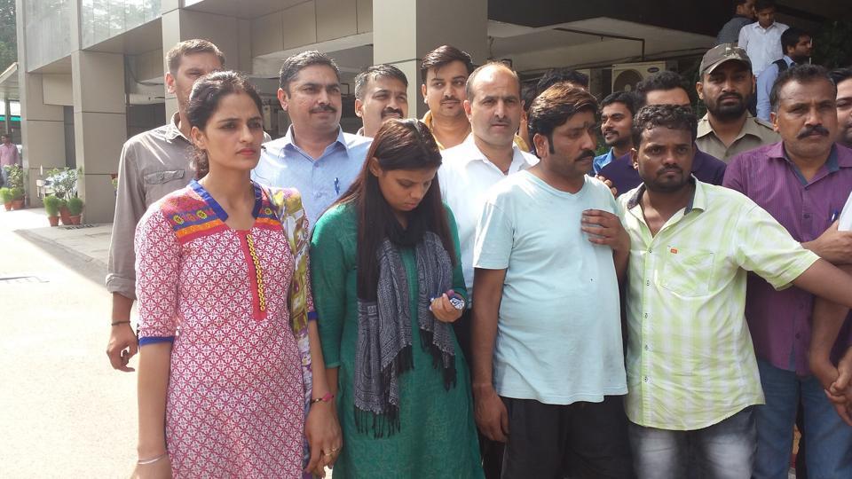 The gang members in police custody.