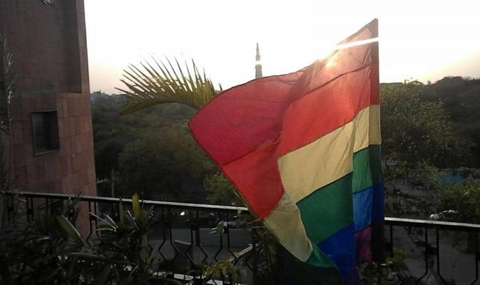 A large rainbow flag at the cafe proclaims its support for the community.