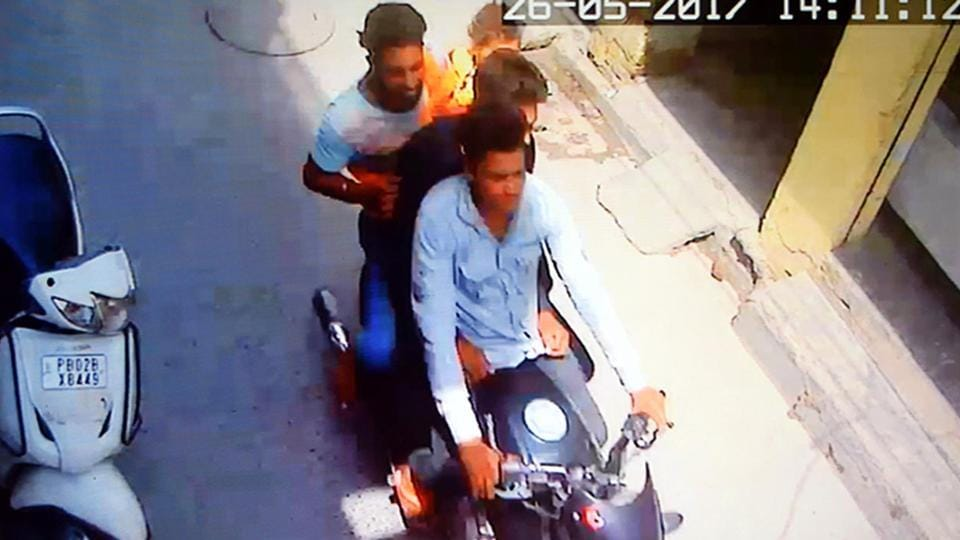 A CCTVgrab of motorcycle-borne assailants kidnapping the child.